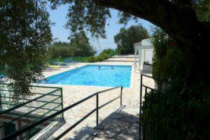 Trish and Di in the pool at Villa Andonis